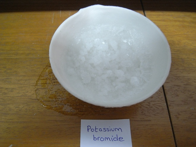 Potassium bromide in an evaporating basin showing crystal creep